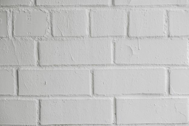 Nowoczesna biała ceglana ściana tekstura tło dla tapety i projektowania graficznego stron internetowych.
