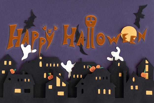 Nowoczesna karta upominkowa z halloween na ciemnym tle. helloween w stylu cięcia papieru na ciemnym tle. wesołego halloween.