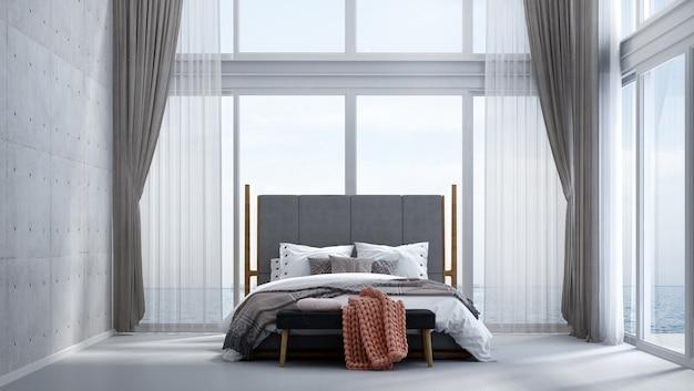 Nowoczesna, przytulna sypialnia, betonowa ściana i widok na morze
