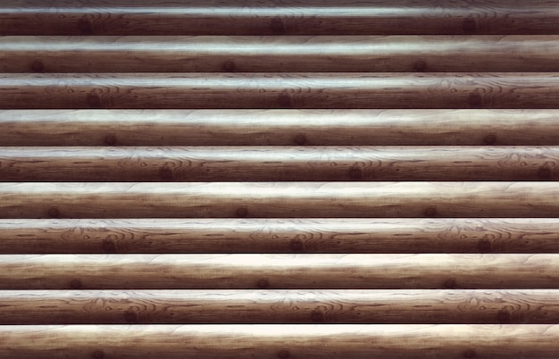 Nowoczesna, ręcznie ciosana naturalna ściana z bali, fasada, tekstura fragmentu. rustykalne ściany z bali poziome drewniane tła. fragment niepomalowanych drewnianych bali okorowanych stodoła lub tapeta ścienna do domu. drewno heblowane