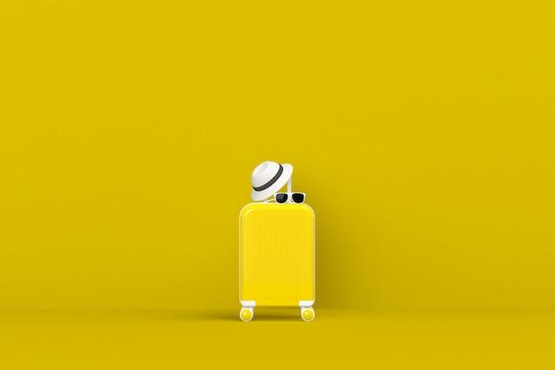 Nowoczesna żółta walizka z okularami przeciwsłonecznymi i kapeluszem na żółtym
