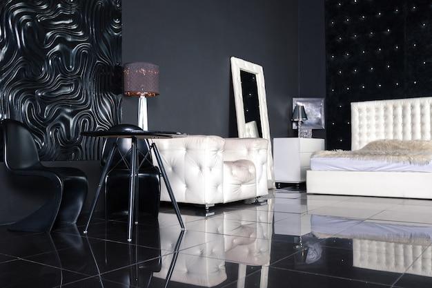 Nowoczesne ciemne, luksusowe czarne wnętrze z białymi eleganckimi meblami