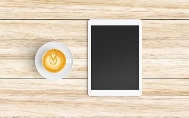 Nowoczesne miejsce do pracy z filiżanką kawy, tabletu i smartfona na drewnie