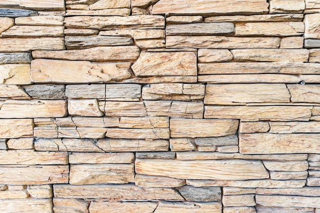Nowoczesne tło ściany z cegły kamienia. kamienna tekstura.