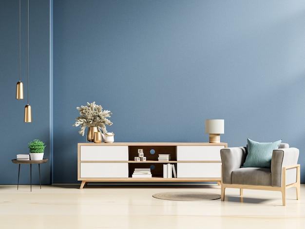 Nowoczesne wnętrze salonu z szafką i fotelem na ciemnoniebieskiej ścianie