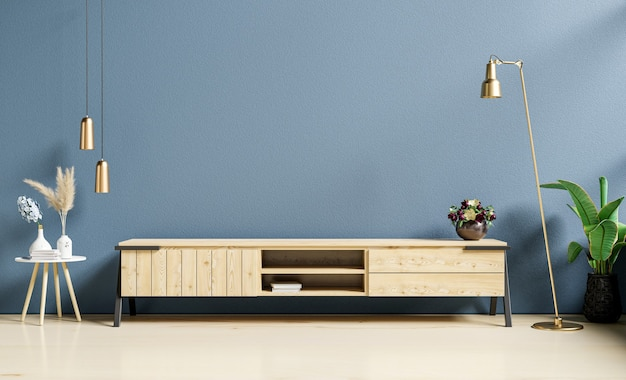 Nowoczesne wnętrze salonu z szafką na telewizor na ciemnoniebieskim tle ściany, renderowanie 3d