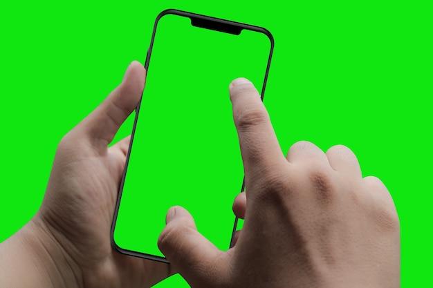 Nowoczesny inteligentny telefon w ręku. zielony ekran i tło