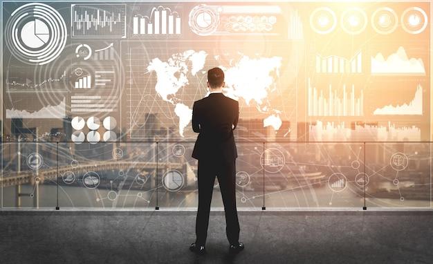 Nowoczesny interfejs graficzny pokazuje na monitorze masowe informacje o raporcie sprzedaży, wykresie zysków i analizie trendów giełdowych.