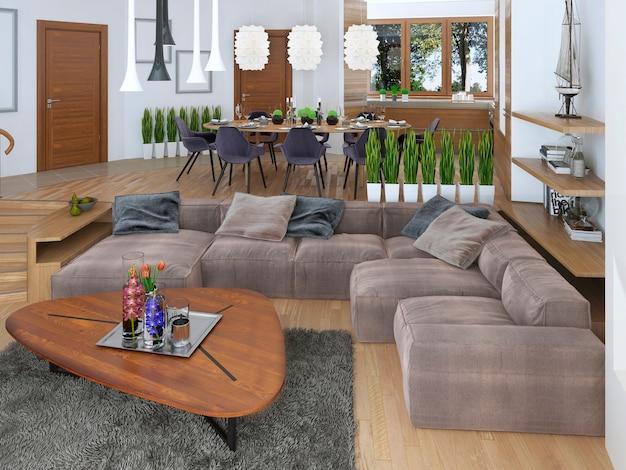 Nowoczesny salon w stylu loftowym i płynnie wkomponowany w kuchnię z jadalnią z dużym narożnikiem.