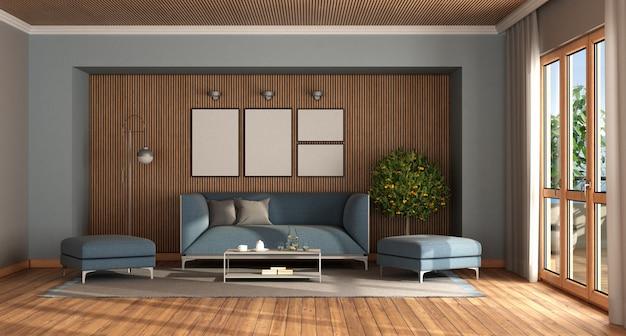 Nowoczesny salon z elegancką niebieską sofą i podnóżkiem