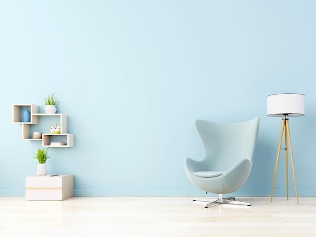 Nowoczesny salon z niebieskim fotelem ma szafkę i drewniane półki na drewnianych podłogach