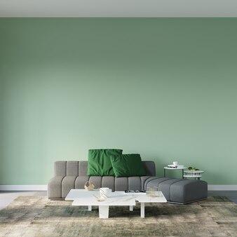 Nowoczesny salon z szarą sofą i zielonymi poduszkami przed zieloną pustą ścianą
