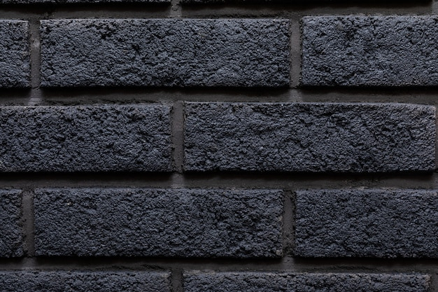 Nowożytny czarny ściana z cegieł tekstury tło