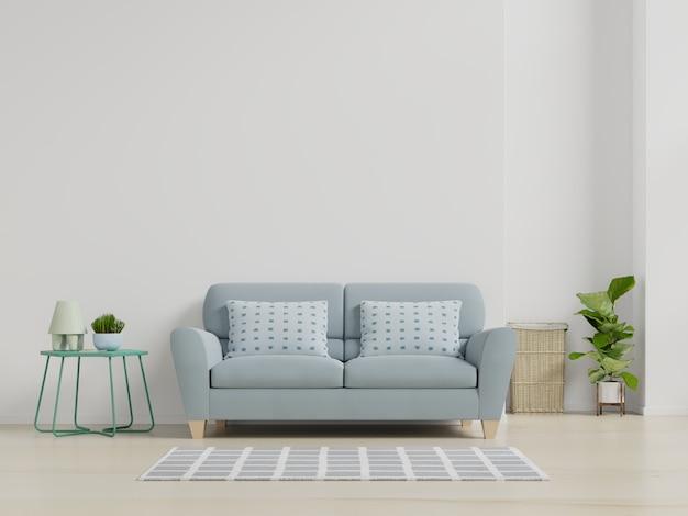 Nowożytny żywy izbowy wnętrze z kanapą i zielonymi roślinami, lampa, stół na biel ściany tle.