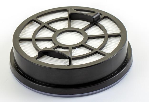 Nowy biały okrągły filtr przeciwpyłowy do odkurzacza.