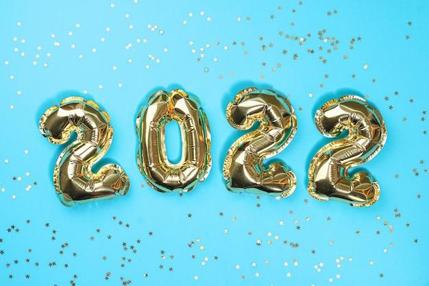 Nowy rok balony foliowe numery na niebieskim tle nowy rok bożego narodzenia