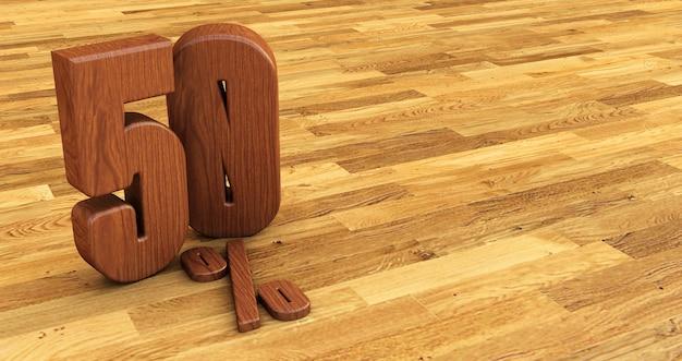 Numer drewniany na białym tle na drewnianej podłodze. 50 pięćdziesiąt procent sprzedaży.
