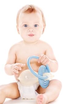 Obraz chłopca z dużym smoczkiem na białym