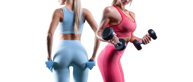Obraz dwóch sportowych seksownych dziewczyn na białym tle. koncepcja fitness. wysoka jakość