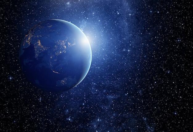 Obraz gwiazd i planety w galaktyce. niektóre elementy tego obrazu dostarczone przez nasa