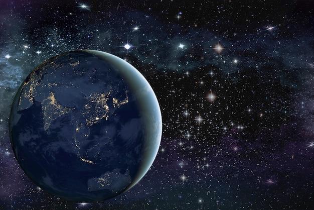Obraz planety ziemia w przestrzeni. wokół gwiazd i mgławicy. elementy tego obrazu zostały umeblowane