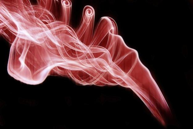 Obraz przedstawiający czerwone kłęby dymu na czarnym tle