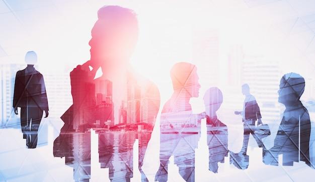 Obraz sylwetka grupy ludzi biznesu na tle miasta