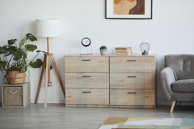 Obraz tła minimalistycznego wnętrza domu ozdobionego roślinami, skupienie się na drewnianych szafkach, kopia przestrzeń