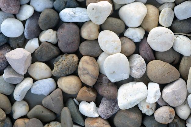 Obraz tła to kamienny wzór, który miesza kształt i kolor kamienia.