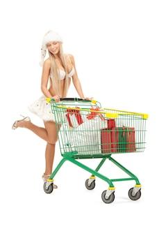Obrazek wesołego pomocnika mikołaja z torbami na zakupy shopping