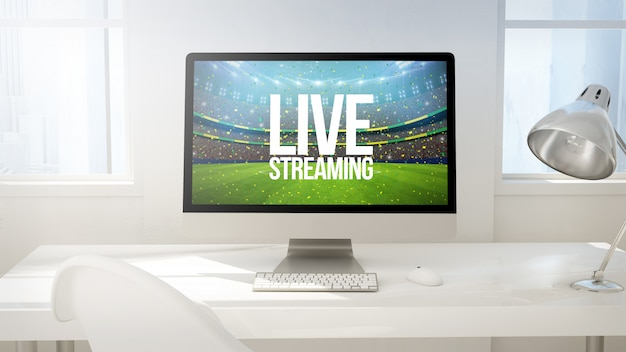 Obszar roboczy z ekranem komputera podczas przesyłania strumieniowego na żywo