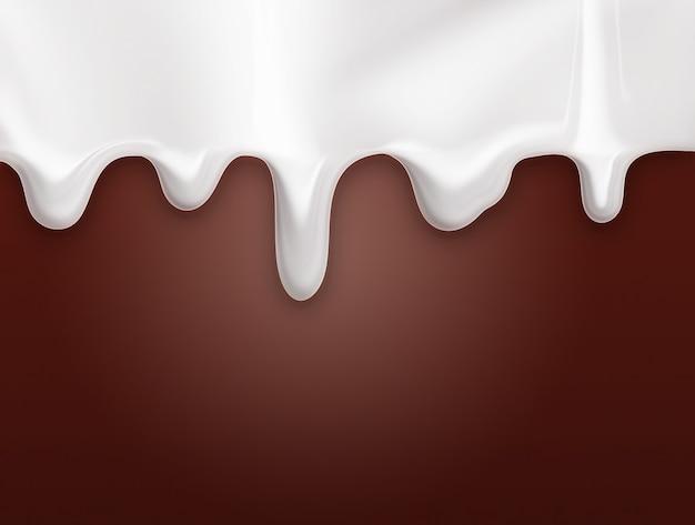 Ociekające mlekiem na czekoladowym tle