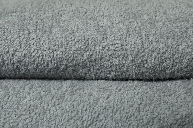 Oczyść w całości szare, złożone ręczniki, z bliska