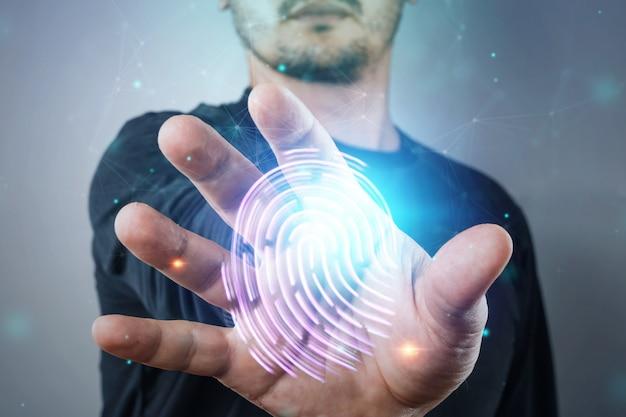Odcisk palca z hologramem, cyberbezpieczeństwo informatyczne męskiej ręki