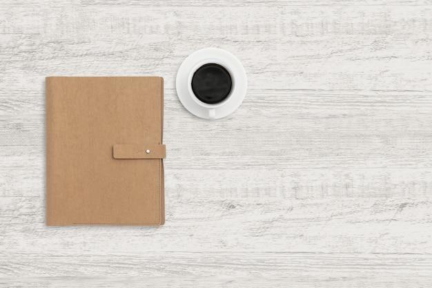 Odgórnego widoku biznesowy tło notatnik i filiżanka na drewnianej teksturze.
