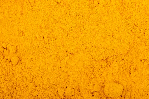 Odgórny widok kurkumy proszka tło i tekstura