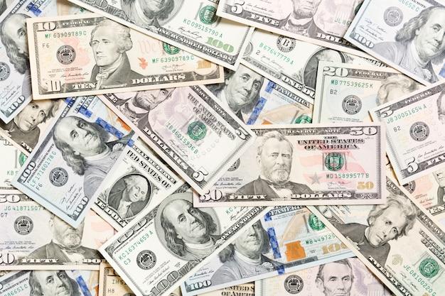 Odgórny widok różnorodny dolar gotówki tło. różne banknoty. bogactwo i bogata koncepcja
