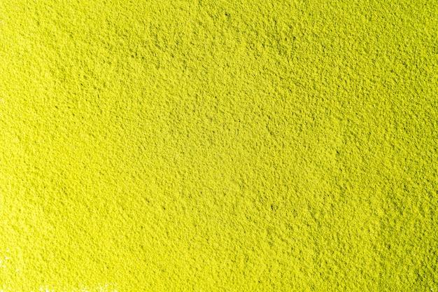 Odgórny widok zielonej herbaty matcha proszka tło.