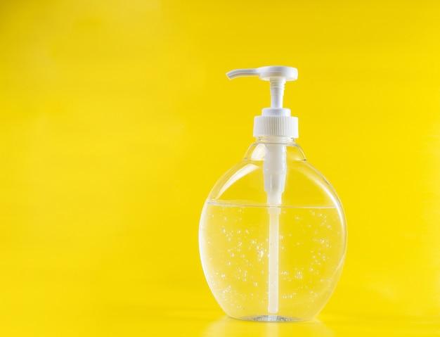 Odkażacz do butelek, przezroczysty żel, alkoholowy środek dezynfekujący do rąk, pionowy, biały, neutralny żółty