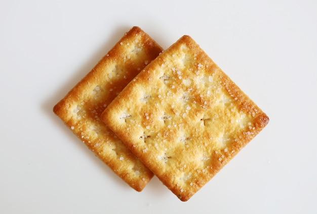 Odosobnionego krakers przekąski deserowy ciastko na białym tle
