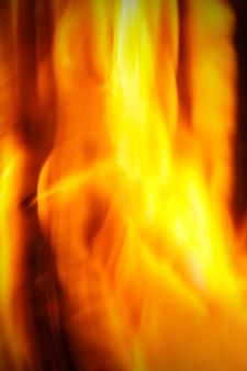 Ogień płomień tło. rama pionowa.
