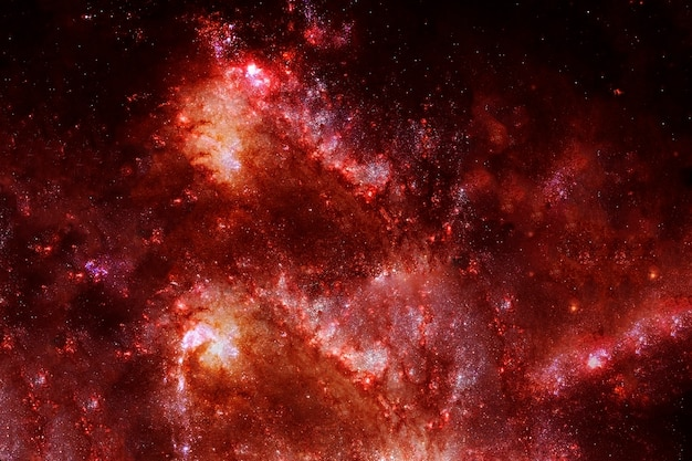Ognista galaktyka na ciemnym tle. elementy tego obrazu dostarczyła nasa. zdjęcie wysokiej jakości
