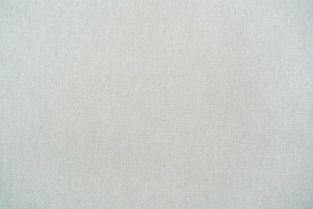 Ogólny, a nie specyficzny wzór tkaniny w tle. natywny wzór tkaniny bawełnianej z bliska.