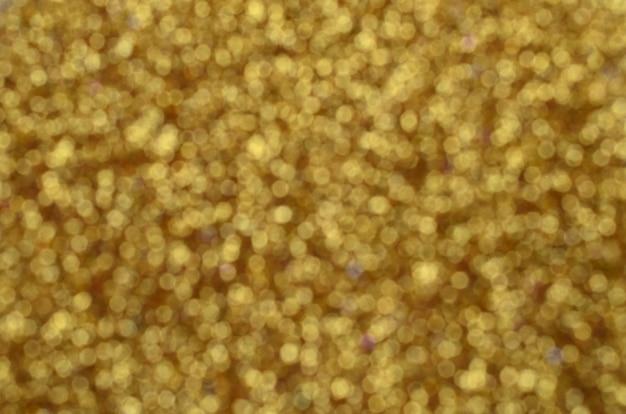 Ogromna ilość żółtych dekoracyjnych cekinów