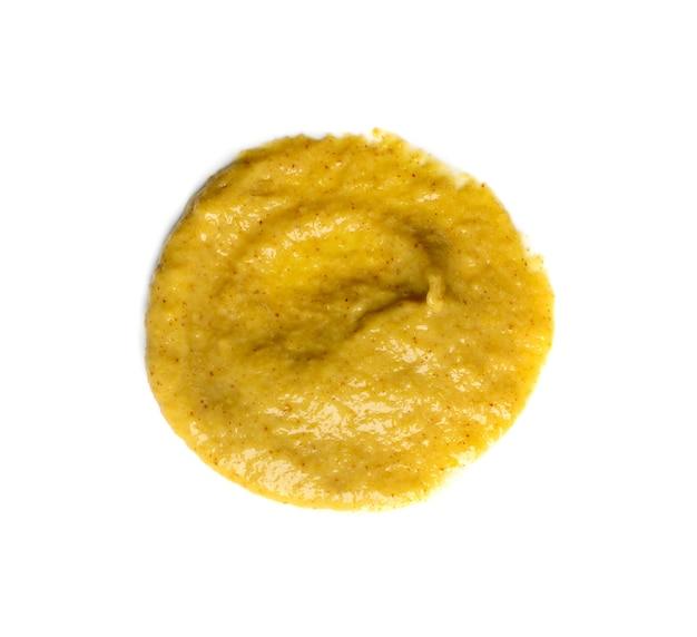 Okrągła kropla sosu musztardowego na białym tle