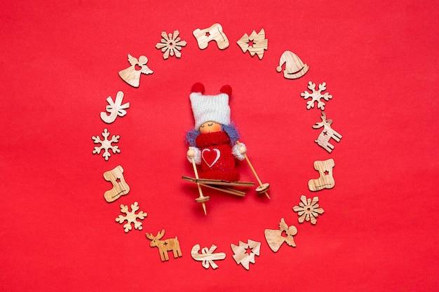 Okrągła rama płatki śniegu, buty, choinka, anioł, jelenie, narciarz dziewczyna na białym tle na czerwonym tle