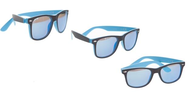 Okulary przeciwsłoneczne na białym tle, letnie luksusowe akcesoria