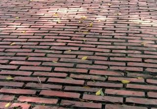 Old red brick road, stare