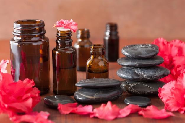 Olejek eteryczny kwiaty azalii czarne kamienie do masażu