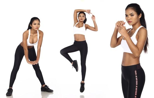 Opalona skóra azjatyckie kobiety nosić fitness sport biustonosz spodnie do jogi sneakers. pełnej długości kobiece ćwiczenia i pot zdrowy na białym tle na białym tle